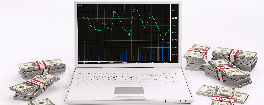 An image of a computer with graphs and stacks of cash surrounding it