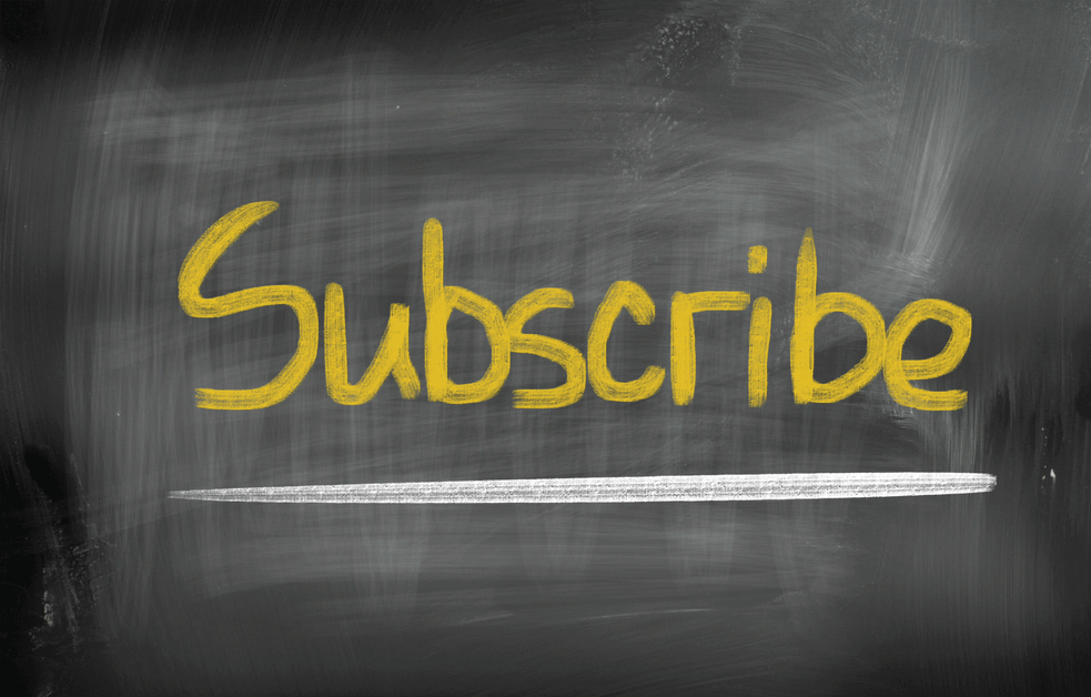 """An image of the word """"Subscribe"""" written boldly on a chalkboard"""